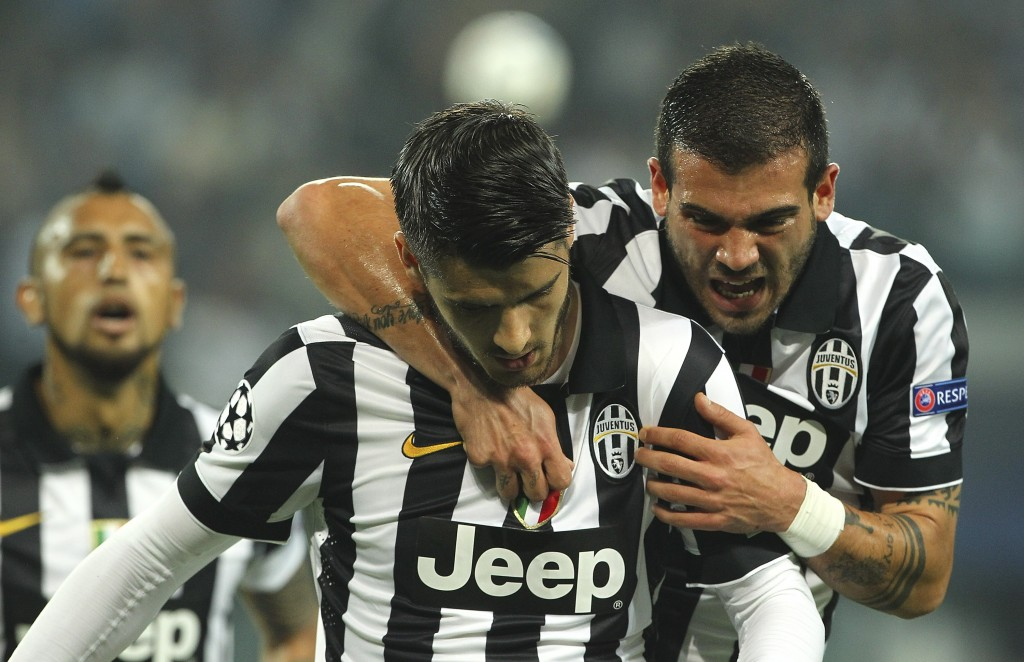 TURIN, ITALY - MAY 05: Alvaro Morata of Juventus FC celebrates with his team-mate Stefano Sturaro after scoring the opening goal during the UEFA Champions League semi final match between Juventus and Real Madrid CF at Juventus Arena on May 5, 2015 in Turin, Italy. (Photo by Marco Luzzani/Getty Images)