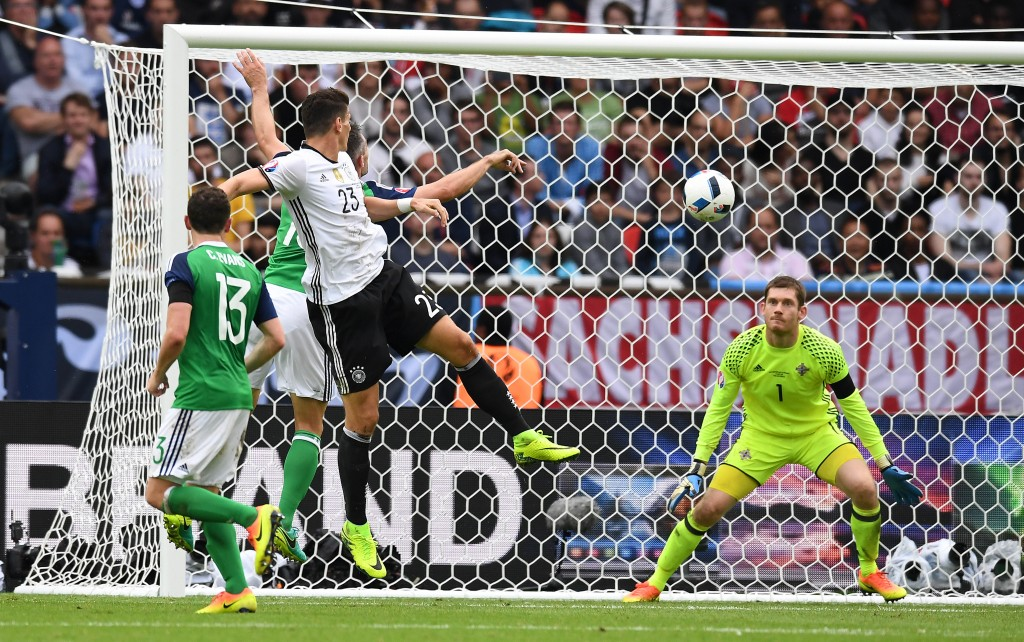 PARIS, FRANCE - JUNE 21: Mario Gomez of Germany heads at goal during the UEFA EURO 2016 Group C match between Northern Ireland and Germany at Parc des Princes on June 21, 2016 in Paris, France. (Photo by Charles McQuillan/Getty Images)