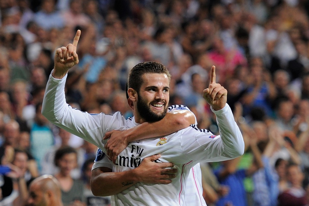 MADRID, SPAIN - SEPTEMBER 16: Nacho Fernandez of Real Madrid celebrates after scoring Real's opening goal during the UEFA Champions League Group B match between Real Madrid CF and FC Basel 1893 on September 16, 2014 in Madrid, Spain. (Photo by Denis Doyle/Getty Images)