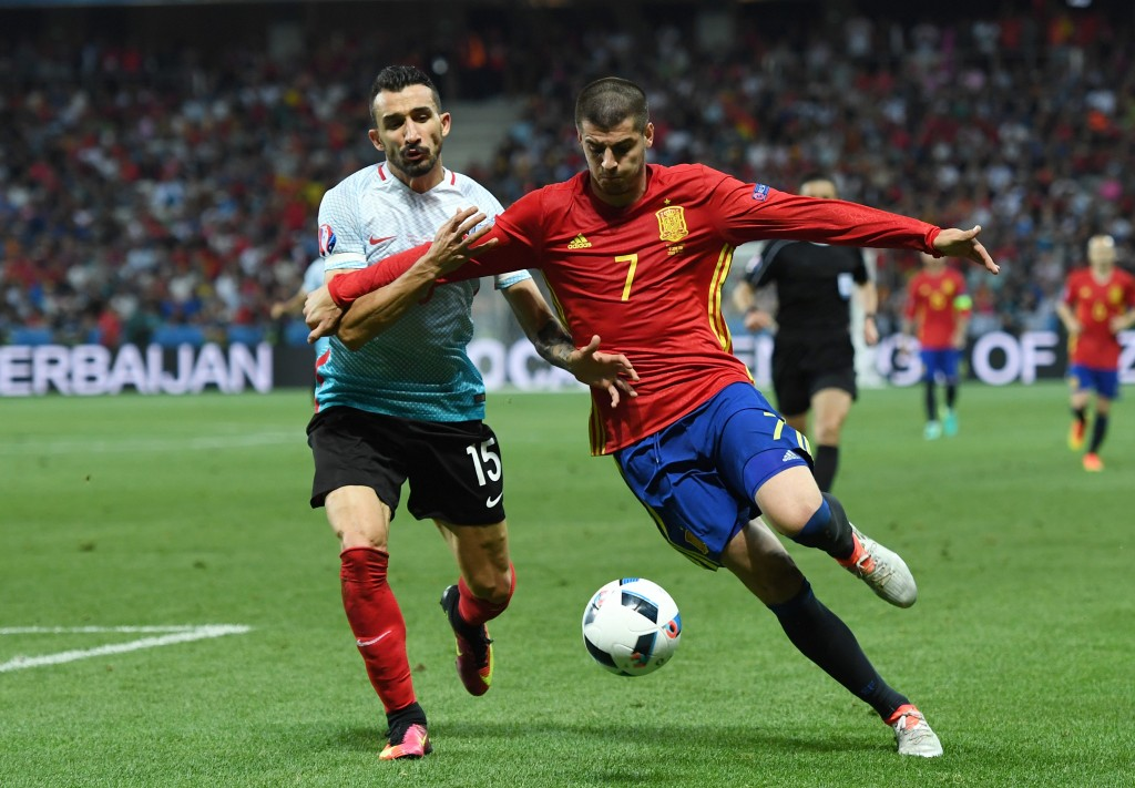 NICE, FRANCE - JUNE 17: Mehmet Topal of Turkey chases down Alvaro Morata of Spain during the UEFA EURO 2016 Group D match between Spain and Turkey at Allianz Riviera Stadium on June 17, 2016 in Nice, France. (Photo by David Ramos/Getty Images)