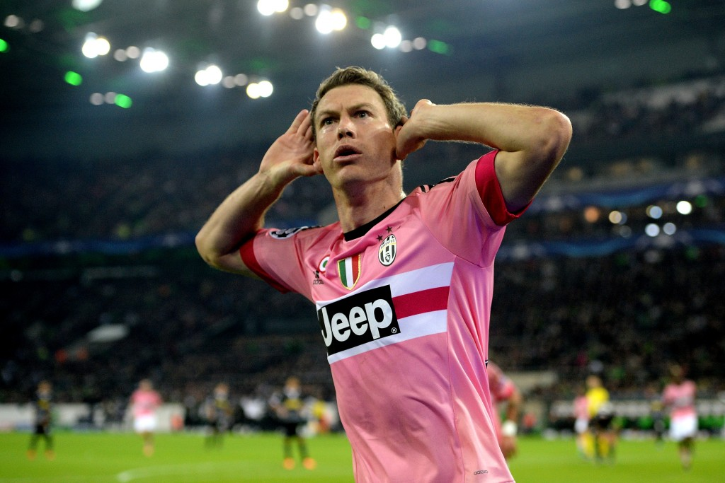 MOENCHENGLADBACH, GERMANY - NOVEMBER 03: Stephan Lichtsteiner of Juventus celebrates after scoring his team's first goal during the UEFA Champions League group stage match between VfL Borussia Monchengladbach and Juventus FC on November 3, 2015 in Moenchengladbach, Germany. (Photo by Sascha Steinbach/Bongarts/Getty Images)