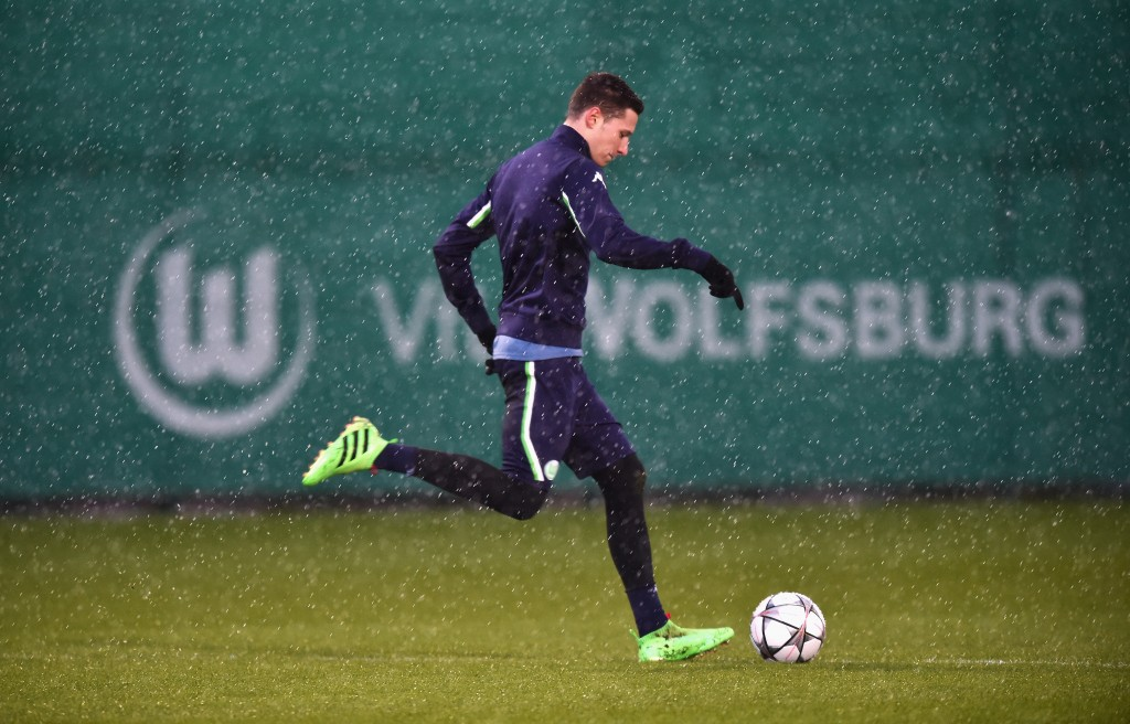 WOLFSBURG, GERMANY - MARCH 07: Julian Draxler of Wolfsburg runs with the ball during a training session prior to the UEFA Champions League match against Gent at Volkswagen Arena on March 7, 2016 in Wolfsburg, Germany. (Photo by Stuart Franklin/Bongarts/Getty Images)
