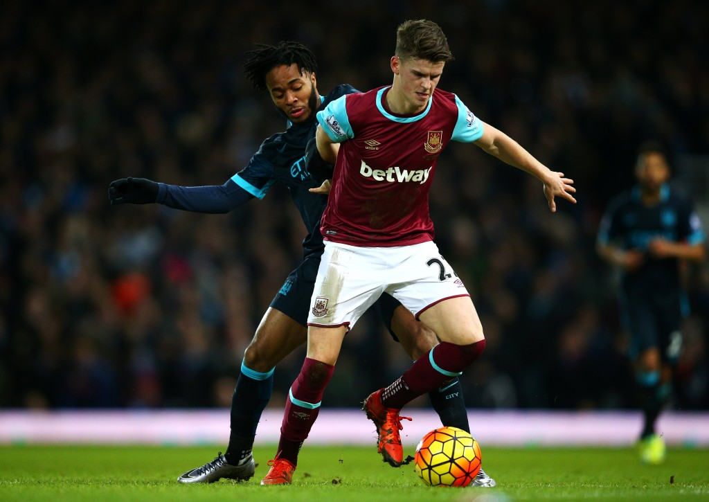 LONDON, ENGLAND - JANUARY 23: Sam Byram of West Ham United holds off Raheem Sterling of Manchester City during the Barclays Premier League match between West Ham United and Manchester City at the Boleyn Ground on January 23, 2016 in London, England. (Photo by Paul Gilham/Getty Images)