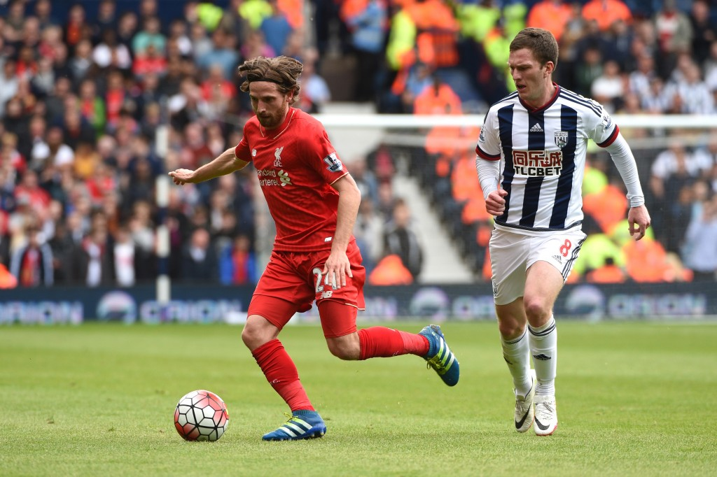 WEST BROMWICH, ENGLAND - MAY 15: Joe Allen of Liverpool and Craig Gardner of West Bromwich Albion compete for the ball during the Barclays Premier League match between West Bromwich Albion and Liverpool at The Hawthorns on May 15, 2016 in West Bromwich, England.