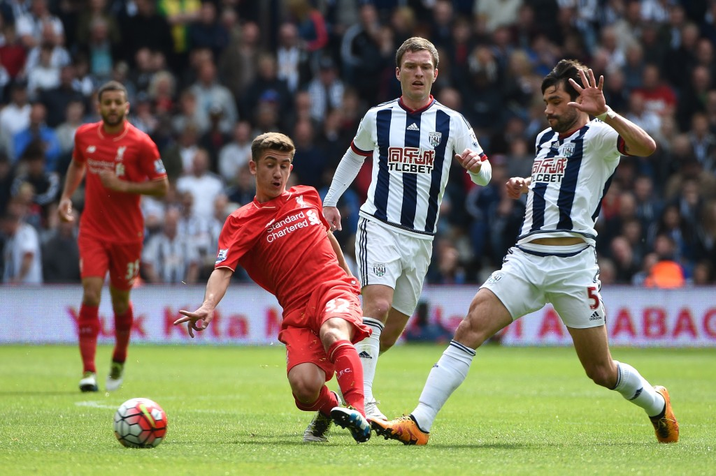 WEST BROMWICH, ENGLAND - MAY 15: Cameron Brannagan of Liverpool and Claudio Yacob of West Bromwich Albion compete for the ball during the Barclays Premier League match between West Bromwich Albion and Liverpool at The Hawthorns on May 15, 2016 in West Bromwich, England.