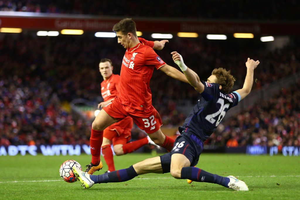 LIVERPOOL, ENGLAND - JANUARY 30: Cameron Brannagan of Liverpool is tackled by Nikica Jelavic of West Ham United during the Emirates FA Cup Fourth Round match between Liverpool and West Ham United at Anfield on January 30, 2016 in Liverpool, England. (Photo by Clive Brunskill/Getty Images)