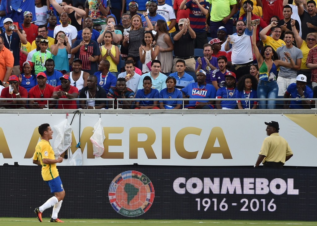 Brazil's Philippe Coutinho celebrates after scoring against Haiti during a Copa America Centenario football match in Orlando, Florida, United States, on June 8, 2016. / AFP / Hector RETAMAL (Photo credit should read HECTOR RETAMAL/AFP/Getty Images)