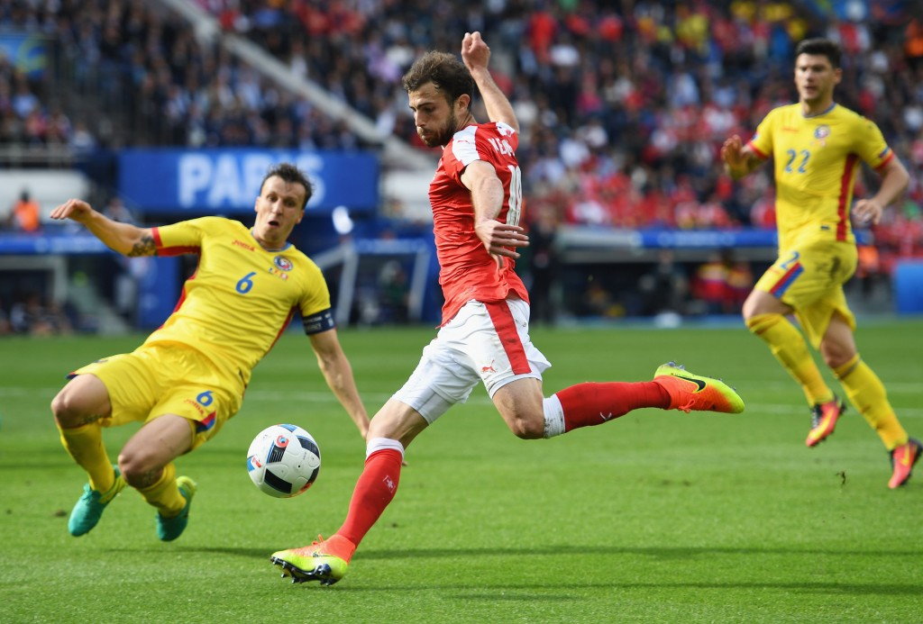 PARIS, FRANCE - JUNE 15: Admir Mehmedi of Switzerland is blocked by Vlad Chiriches of Romania during the UEFA EURO 2016 Group A match between Romania and Switzerland at Parc des Princes on June 15, 2016 in Paris, France. (Photo by Shaun Botterill/Getty Images)
