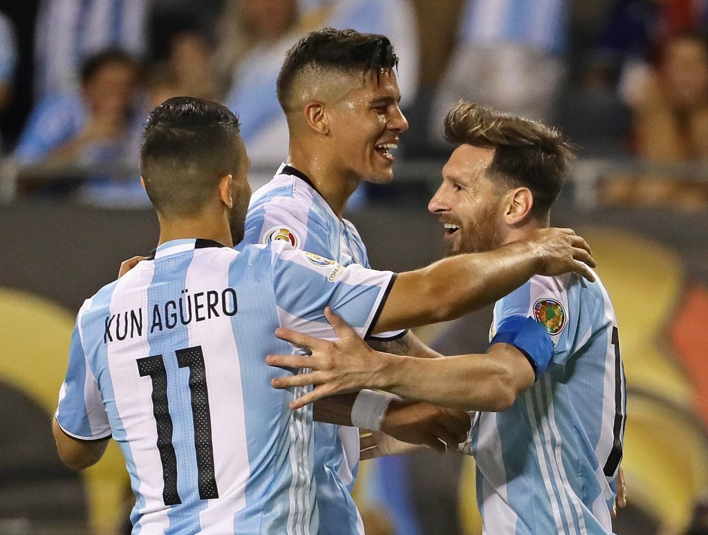 CHICAGO, IL - JUNE 10: Lionel Messi #10 of Argentina (R) celebrates his third goal against Panama with teammates Sergio Aguero #11 and Marcos Rojo during a match in the 2016 Copa America Centenario at Soldier Field on June 10, 2016 in Chicago, Illinois. Argentina defeated Panama 5-0. (Photo by Jonathan Daniel/Getty Images)