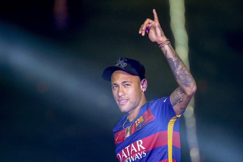 """TOPSHOT - Barcelona's Brazilian forward Neymar acknowledges the crowd during celebrations at the Camp Nou stadium in Barcelona on May 23, 2016 following their Spanish """"Copa del Rey"""" (King's Cup) final football match 2-0 victory over Sevilla FC yesterday also marking the club's 28th Copa del Rey win and the 24th Spanish Liga title. / AFP / JOSEP LAGO (Photo credit should read JOSEP LAGO/AFP/Getty Images)"""