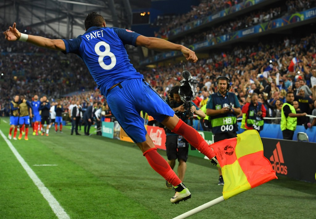 France's forward Dimitri Payet jumps in the air as he celebrates scoring a second goal for France during the Euro 2016 group A football match between France and Albania at the Velodrome stadium in Marseille on June 15, 2016. / AFP / FRANCK FIFE (Photo credit should read FRANCK FIFE/AFP/Getty Images)
