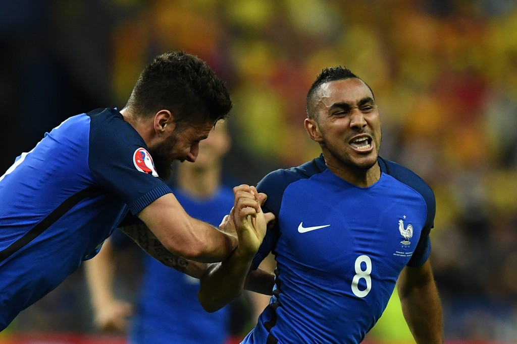 France's forward Dimitri Payet (R) celebrates with France's forward Olivier Giroud after scoring the 2-1 during the Euro 2016 group A football match between France and Romania at Stade de France, in Saint-Denis, north of Paris, on June 10, 2016. / AFP / FRANCK FIFE (Photo credit should read FRANCK FIFE/AFP/Getty Images)