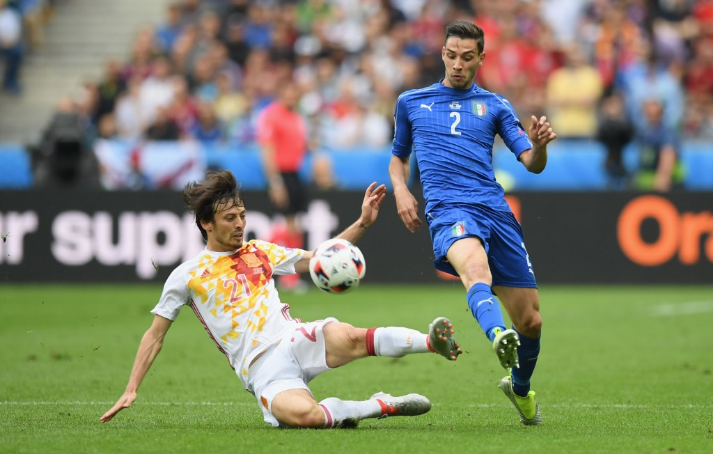 PARIS, FRANCE - JUNE 27: Mattia De Sciglio of Italy is tackled by David Silva of Spain during the UEFA EURO 2016 round of 16 match between Italy and Spain at Stade de France on June 27, 2016 in Paris, France. (Photo by Matthias Hangst/Getty Images)
