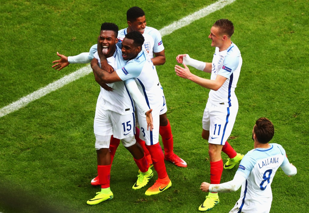 LENS, FRANCE - JUNE 16: Daniel Sturridge (1st L) of England celebrates scoring his team's second goal with his team mates during the UEFA EURO 2016 Group B match between England and Wales at Stade Bollaert-Delelis on June 16, 2016 in Lens, France. (Photo by Clive Rose/Getty Images)