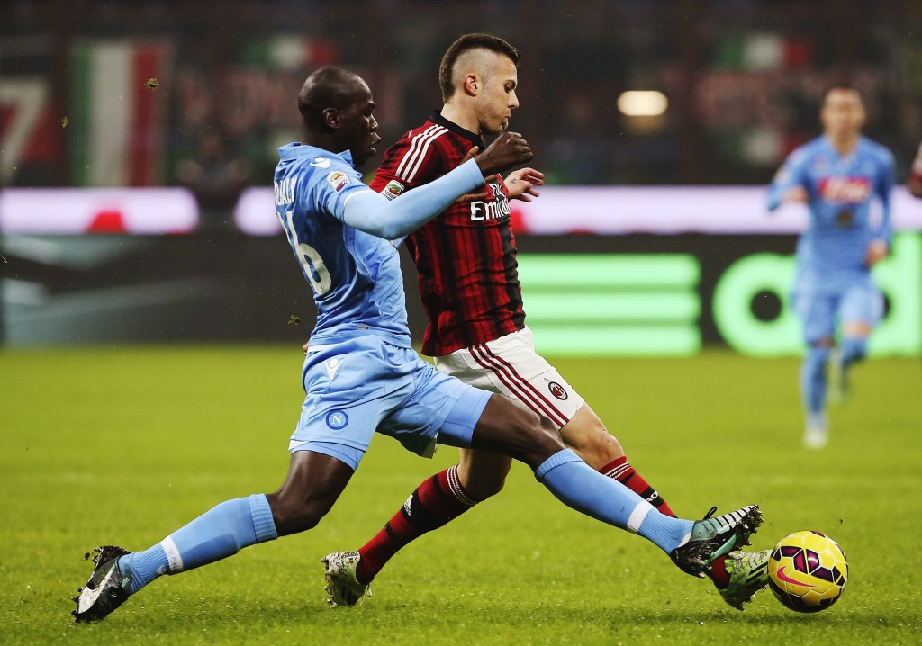 MILAN, ITALY - DECEMBER 14: Jeremy Menez (R) of AC Milan is challenged by Kalidou Koulibaly (L) of SSC Napoli during the Serie A match between AC Milan and SSC Napoli at Stadio Giuseppe Meazza on December 14, 2014 in Milan, Italy. (Photo by Marco Luzzani/Getty Images)
