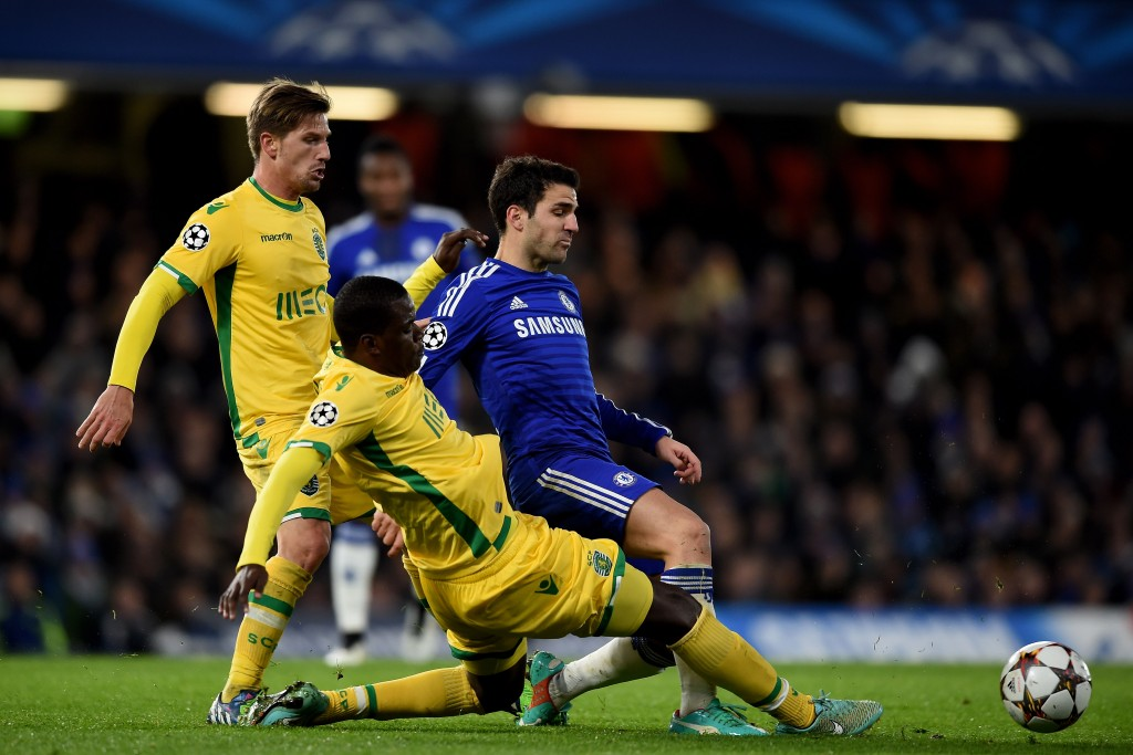 LONDON, ENGLAND - DECEMBER 10: Cesc Fabregas of Chelsea is tackled by William Carvalho of Sporting Lisbon during the UEFA Champions League group G match between Chelsea and Sporting Clube de Portugal at Stamford Bridge on December 10, 2014 in London, United Kingdom. (Photo by Paul Gilham/Getty Images)