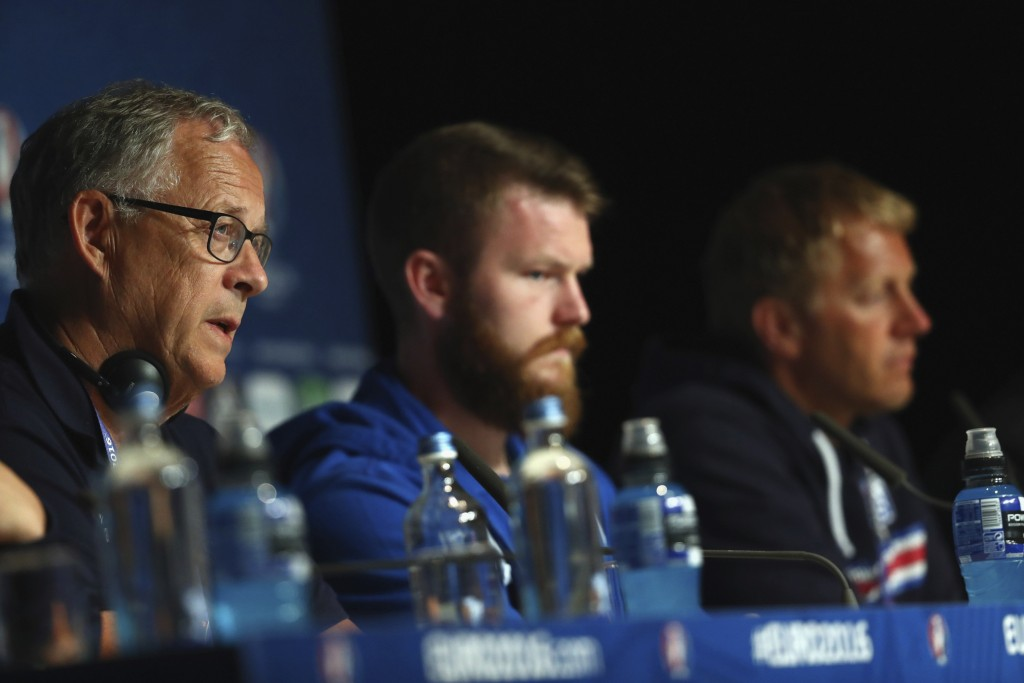 PARIS, FRANCE - JULY 02: In this handout image provided by UEFA Aron Gunnarsson and coaches Lars Lagerback and Heimir Hallgrimsson of Iceland attend a press conference at Stade de France on July 2, 2016 in Paris, France. (Photo by Handout/UEFA via Getty Images)