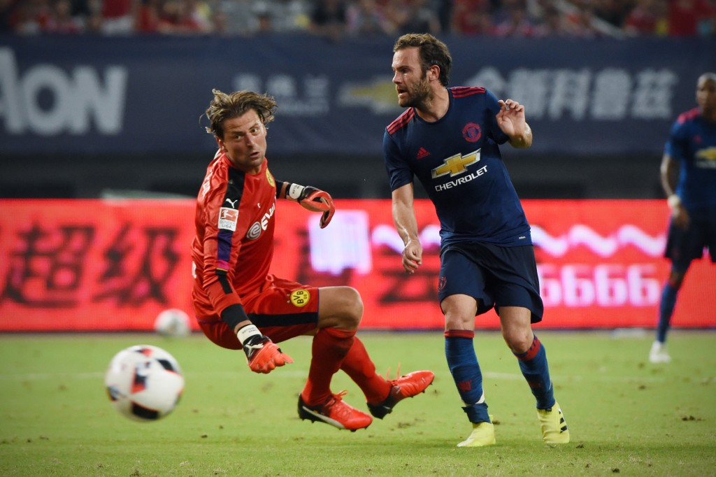 Juan Mata seems to have started on the path of his redemption with Jose Mourinho after a couple of assists in two pre-season games for the Spaniard. (Picture Courtesy - AFP/Getty Images)