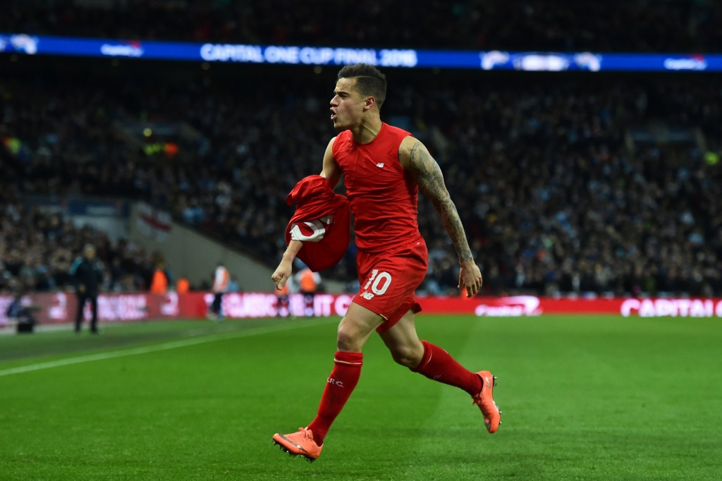 Liverpool's Brazilian midfielder Philippe Coutinho celebrates scoring their first goal to equalise 1-1 during the English League Cup final football match between Liverpool and Manchester City at Wembley Stadium in London on February 28, 2016. / AFP / BEN STANSALL / RESTRICTED TO EDITORIAL USE. No use with unauthorized audio, video, data, fixture lists, club/league logos or 'live' services. Online in-match use limited to 75 images, no video emulation. No use in betting, games or single club/league/player publications. / (Photo credit should read BEN STANSALL/AFP/Getty Images)
