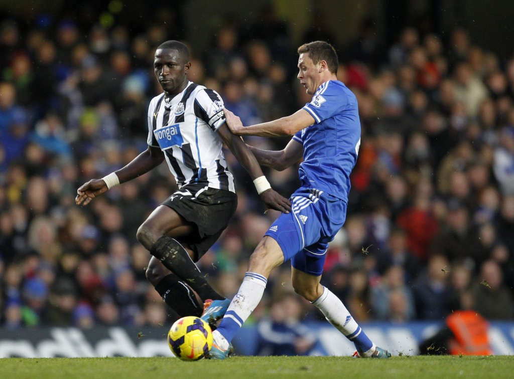 Newcastle United's French midfielder Moussa Sissoko (L) vies with Chelsea's Serbian midfielder Nemanja Matic during the English Premier League football match between Chelsea and Newcastle United at Stamford Bridge in west London on February 8, 2014. Chelsea won 3-0. AFP PHOTO / IAN KINGTON RESTRICTED TO EDITORIAL USE. No use with unauthorized audio, video, data, fixture lists, club/league logos or live services. Online in-match use limited to 45 images, no video emulation. No use in betting, games or single club/league/player publications. (Photo credit should read IAN KINGTON/AFP/Getty Images)