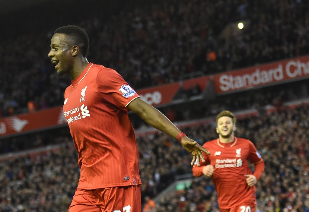 Liverpool's Belgian striker Divock Origi (L) celebrates after scoring during the English Premier League football match between Liverpool and Everton at Anfield in Liverpool, north west England on April 20, 2016. / AFP / PAUL ELLIS / RESTRICTED TO EDITORIAL USE. No use with unauthorized audio, video, data, fixture lists, club/league logos or 'live' services. Online in-match use limited to 75 images, no video emulation. No use in betting, games or single club/league/player publications. / (Photo credit should read PAUL ELLIS/AFP/Getty Images)