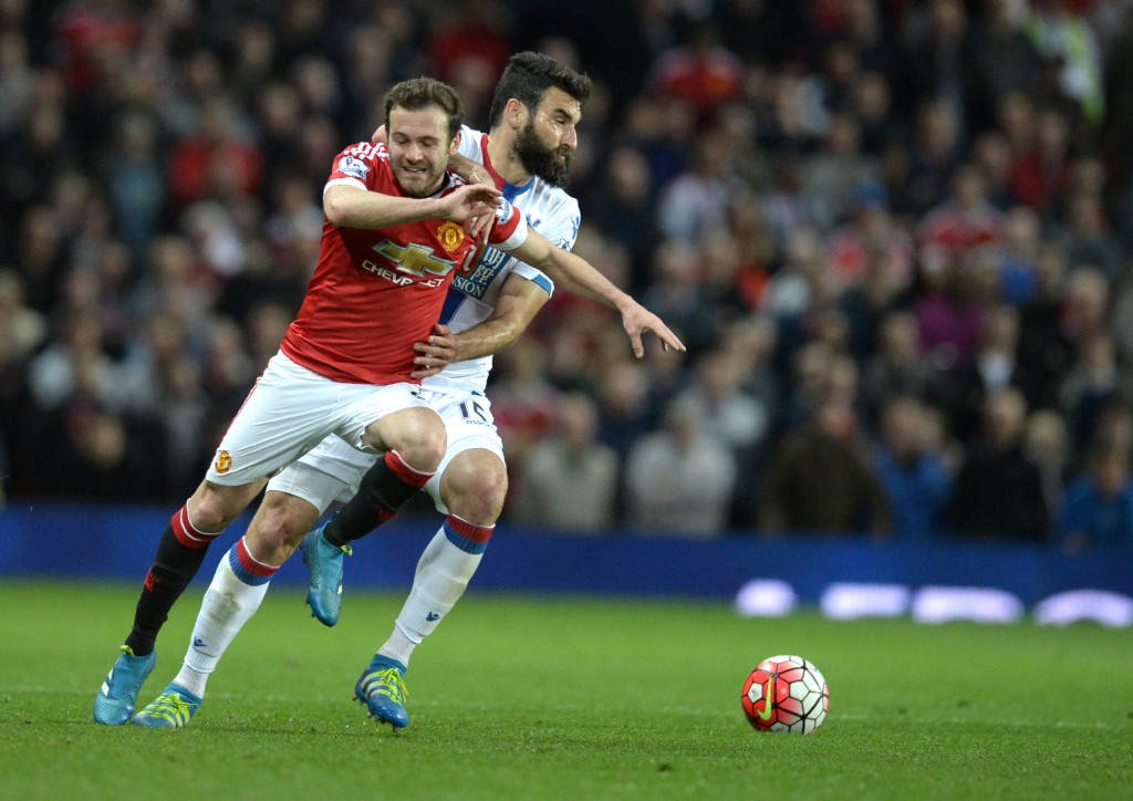 Manchester United's Spanish midfielder Juan Mata (L) is fouled by Crystal Palace's Australian midfielder Mile Jedinak during the English Premier League football match between Manchester United and Crystal Palace at Old Trafford in Manchester, north west England, on April 20, 2016. / AFP / OLI SCARFF / RESTRICTED TO EDITORIAL USE. No use with unauthorized audio, video, data, fixture lists, club/league logos or 'live' services. Online in-match use limited to 75 images, no video emulation. No use in betting, games or single club/league/player publications. / (Photo credit should read OLI SCARFF/AFP/Getty Images)
