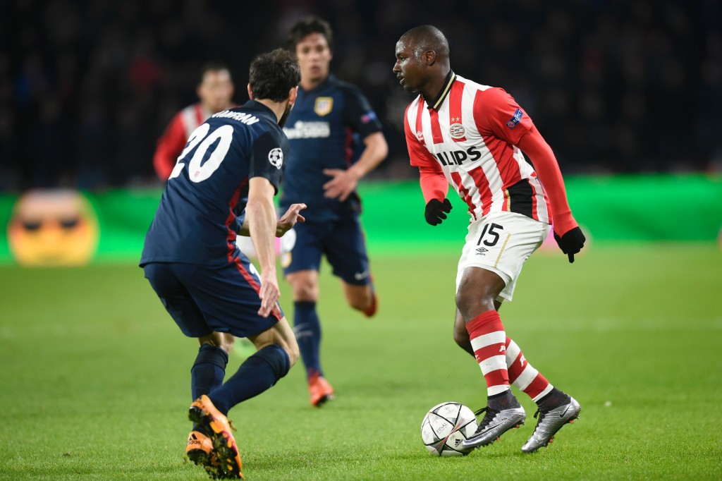 PSV Eindhoven's defender Jetro Willems (R) challenges Atletico Madrid's defender Juanfran during the UEFA Champions League round of 16 first leg football match between PSV Eindhoven and Atletico Madrid at the Philips Stadium in Eindhoven on February 24, 2016. AFP PHOTO / JOHN THYS / AFP / JOHN THYS (Photo credit should read JOHN THYS/AFP/Getty Images)