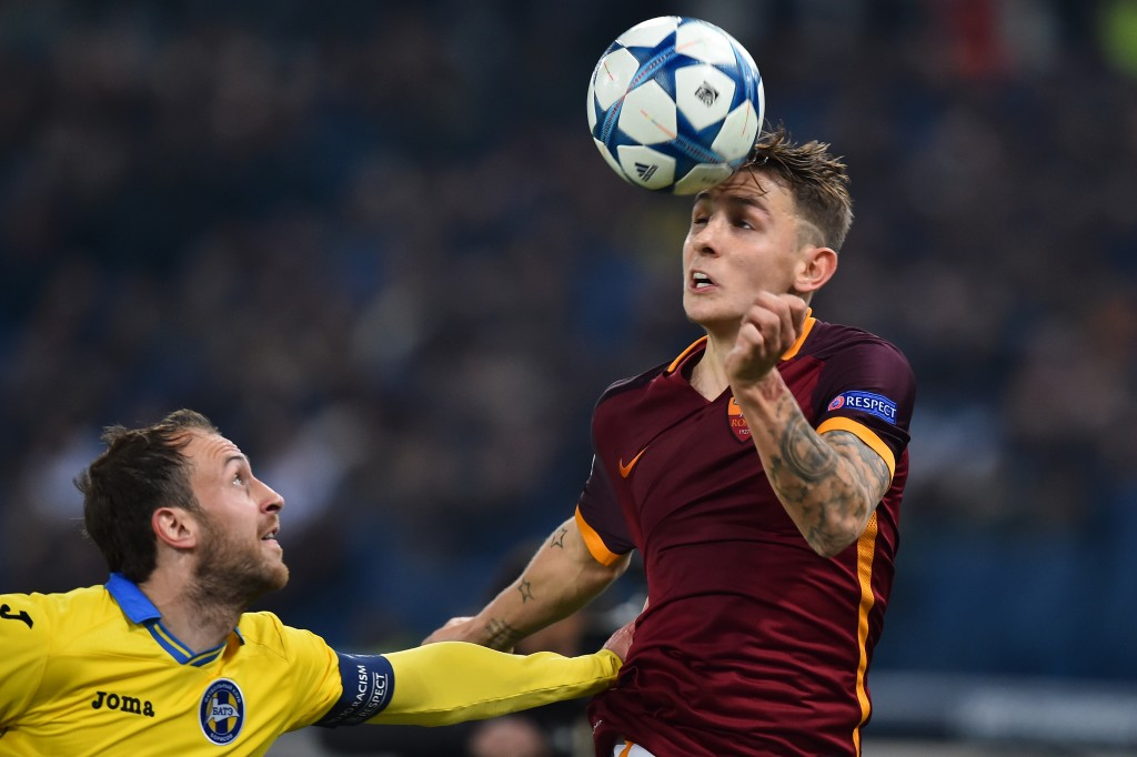 Bate Borisov's midfielder Igor Stasevich (L) vies with Roma's defender from France Lucas Digne during the UEFA Champions League football match AS Roma vs Bate Borisov on December 9, 2015 at the Olympic Stadium in Rome. AFP PHOTO / GABRIEL BOUYS / AFP / GABRIEL BOUYS (Photo credit should read GABRIEL BOUYS/AFP/Getty Images)