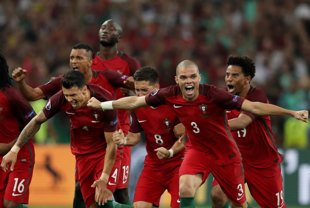 Portugal's players celebrate after winning the Euro 2016 quarter-final football match between Poland and Portugal at the Stade Velodrome in Marseille on June 30, 2016. / AFP / Valery HACHE (Picture Courtesy - Valery Hache/AFP/Getty Images)