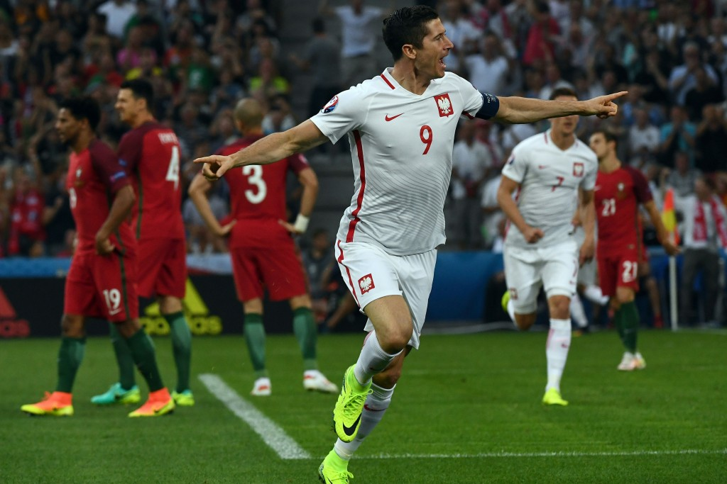 Poland's forward Robert Lewandowski celebrates after scoring the first goal during the Euro 2016 quarter-final football match between Poland and Portugal at the Stade Velodrome in Marseille on June 30, 2016. / AFP / ANNE-CHRISTINE POUJOULAT (Photo credit should read ANNE-CHRISTINE POUJOULAT/AFP/Getty Images)