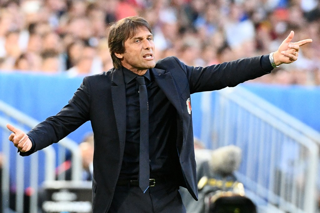 Italy's coach Antonio Conte reacts during the Euro 2016 quarter-final football match between Germany and Italy at the Matmut Atlantique stadium in Bordeaux on July 2, 2016. / AFP / VINCENZO PINTO (Photo credit should read VINCENZO PINTO/AFP/Getty Images)