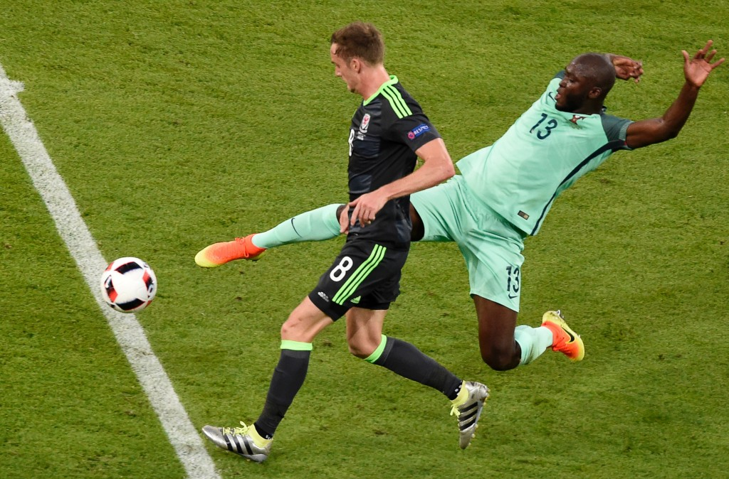 Wales' midfielder Andy King (front) and Portugal's midfielder Danilo Pereira vie for the ball during the Euro 2016 semi-final football match between Portugal and Wales at the Parc Olympique Lyonnais stadium in Décines-Charpieu, near Lyon, on July 6, 2016. / AFP / JEAN-PHILIPPE KSIAZEK (Photo credit should read JEAN-PHILIPPE KSIAZEK/AFP/Getty Images)