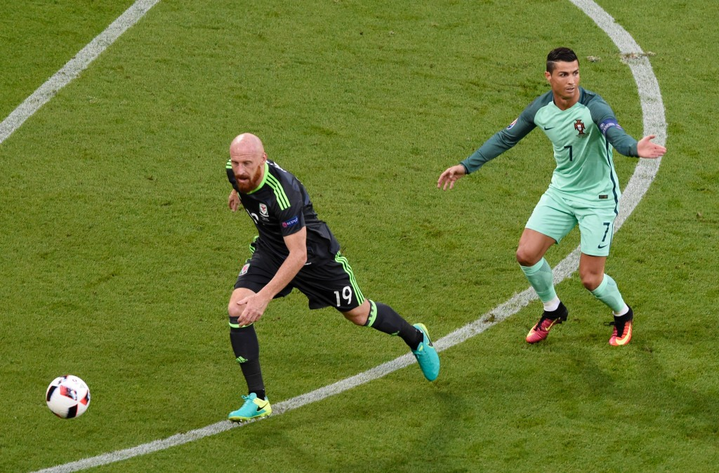 (LtoR) Wales' defender James Collins and Portugal's forward Cristiano Ronaldo vie for the ball during the Euro 2016 semi-final football match between Portugal and Wales at the Parc Olympique Lyonnais stadium in Décines-Charpieu, near Lyon, on July 6, 2016. / AFP / JEAN-PHILIPPE KSIAZEK (Photo credit should read JEAN-PHILIPPE KSIAZEK/AFP/Getty Images)