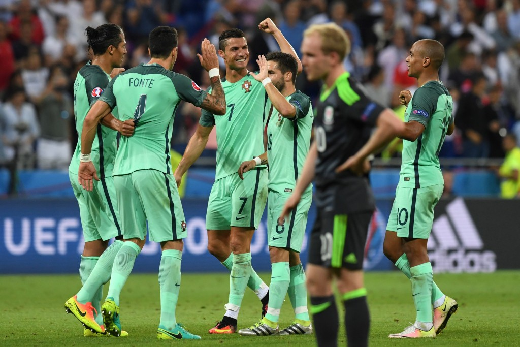 Portuguese players celebrate at the end of the Euro 2016 semi-final football match between Portugal and Wales at the Parc Olympique Lyonnais stadium in Décines-Charpieu, near Lyon, on July 6, 2016. / AFP / Francisco LEONG (Photo credit should read FRANCISCO LEONG/AFP/Getty Images)