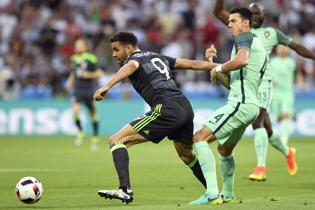 Wales' forward Hal Robson-Kanu vies for the ball against Portugal's defender Fonte during the Euro 2016 semi-final football match between Portugal and Wales at the Parc Olympique Lyonnais stadium in Décines-Charpieu, near Lyon, on July 6, 2016. / AFP / MIGUEL MEDINA (Photo credit should read MIGUEL MEDINA/AFP/Getty Images)