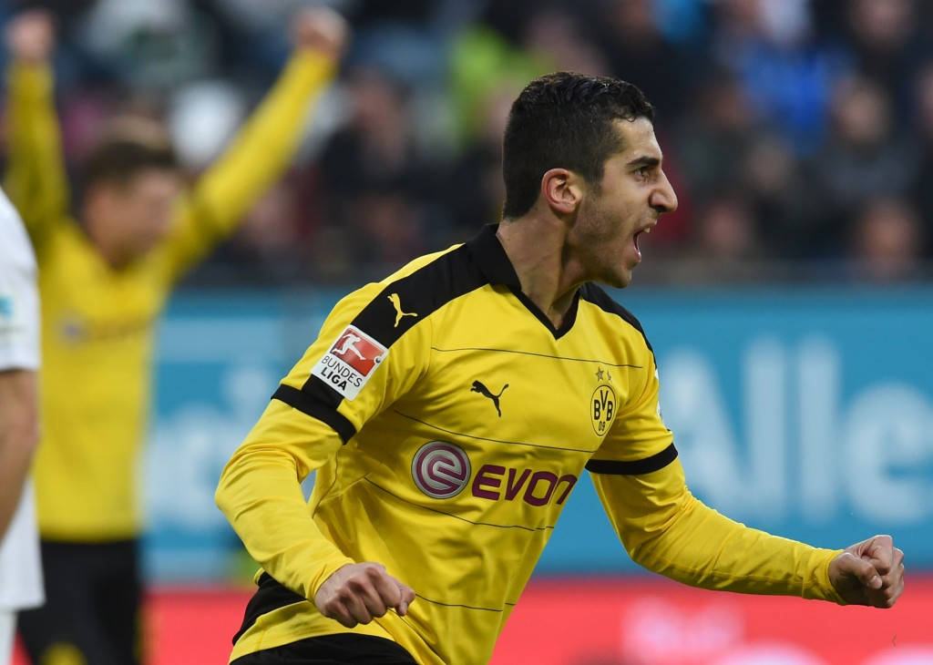 Dortmund's Armenian midfielder Henrikh Mkhitaryan celebrates after scoring during the German Bundesliga first division football match between FC Augsburg vs Borussia Dortmund in Augsburg, southern Germany, on March 20, 2016. / AFP / CHRISTOF STACHE / RESTRICTIONS: DURING MATCH TIME: DFL RULES TO LIMIT THE ONLINE USAGE TO 15 PICTURES PER MATCH AND FORBID IMAGE SEQUENCES TO SIMULATE VIDEO. == RESTRICTED TO EDITORIAL USE == FOR FURTHER QUERIES PLEASE CONTACT DFL DIRECTLY AT + 49 69 650050 (Photo credit should read CHRISTOF STACHE/AFP/Getty Images)
