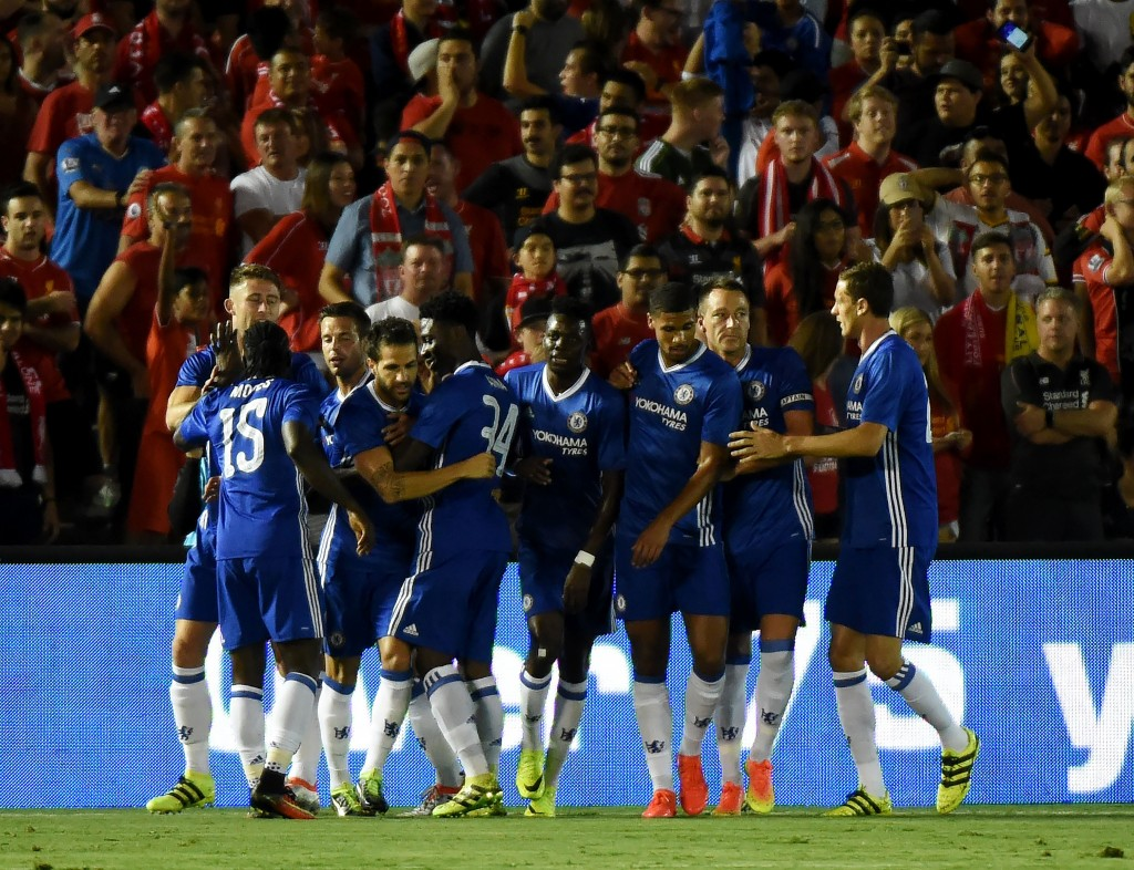 Chelsea defender Gary Cahill (4th L) celebrates with teammates after scoring a goal during their International Champions Cup (ICC) football match against Liverpool at the Rose Bowl Stadium in Pasadena, California on July 27, 2016. Chelsea won 1-0. (Photo by Mark Ralston/AFP/Getty Images)