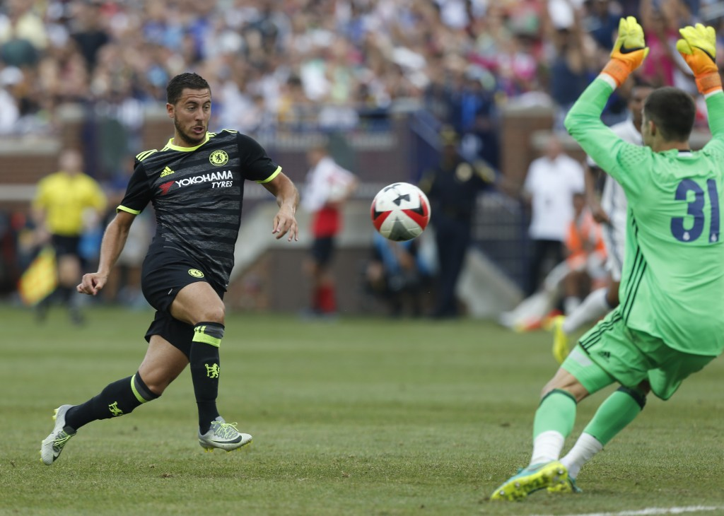 Chelsea midfielder Eden Hazard (L) shoots and scores against Real Madrid goalkeeper Ruben Yanez (R) during an International Champions Cup soccer match in Ann Arbor, Michigan on July 30, 2016. / AFP / Jay LaPrete (Photo credit should read JAY LAPRETE/AFP/Getty Images)