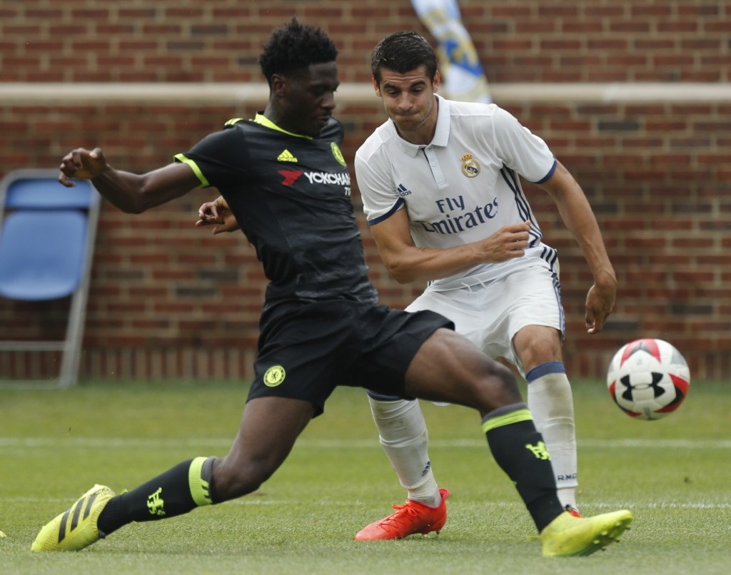 Chelsea defender Ola Aina (L) kicks the ball past Real Madrid forward Alvaro Borja Morata Martin (R) during an International Champions Cup soccer match in Ann Arbor, Michigan on July 30, 2016. / AFP / Jay LaPrete (Photo credit should read JAY LAPRETE/AFP/Getty Images)