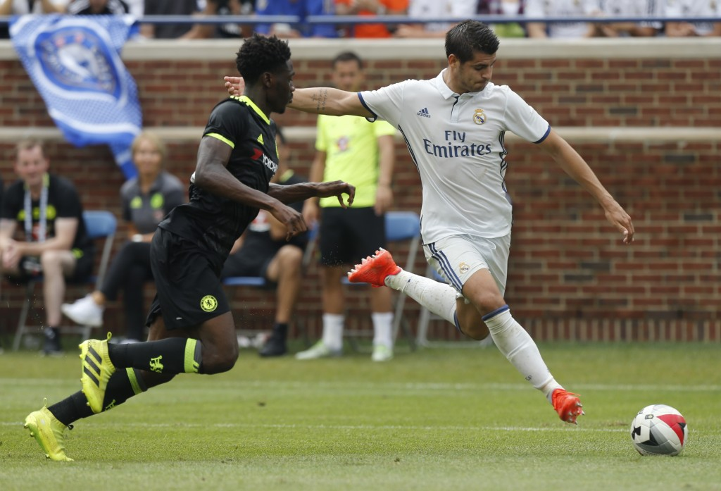 Real Madrid forward Alvaro Borja Morata Martin (R) takes a shot on goal as Chelsea defender Ola Aina (L) defends during an International Champions Cup soccer match in Ann Arbor, Michigan on July 30, 2016. / AFP / Jay LaPrete (Photo credit should read JAY LAPRETE/AFP/Getty Images)