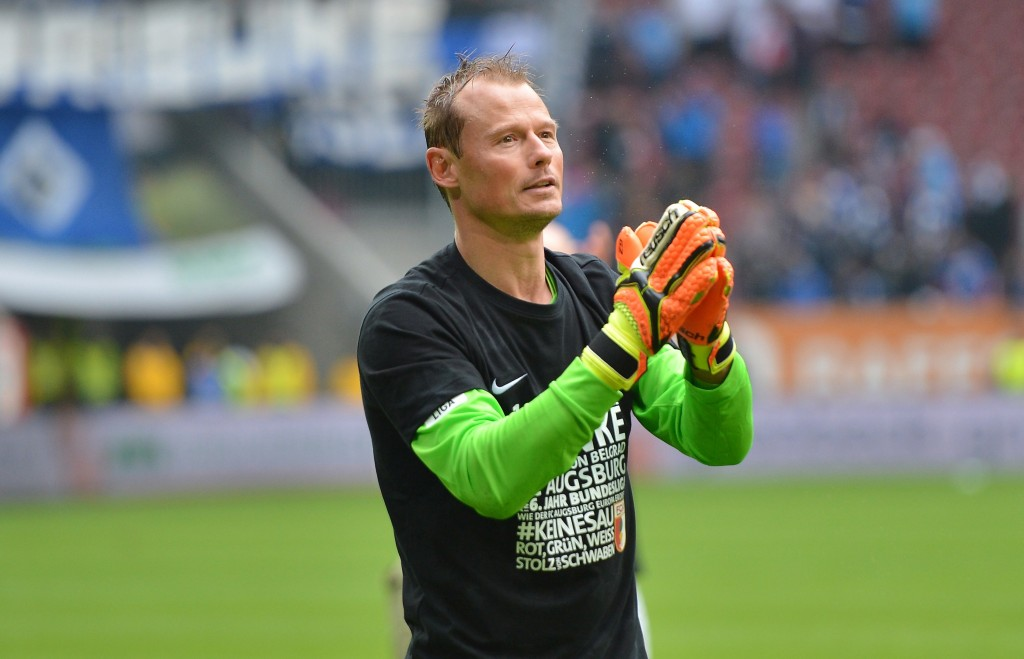 AUGSBURG, GERMANY - MAY 14: Alexander Manninger, goalkeeper of Augsburg celebrates with the fans after the Bundesliga match between FC Augsburg and Hamburger SV at SGL Arena on May 14, 2016 in Augsburg, Germany. (Photo by Micha Will/Bongarts/Getty Images)