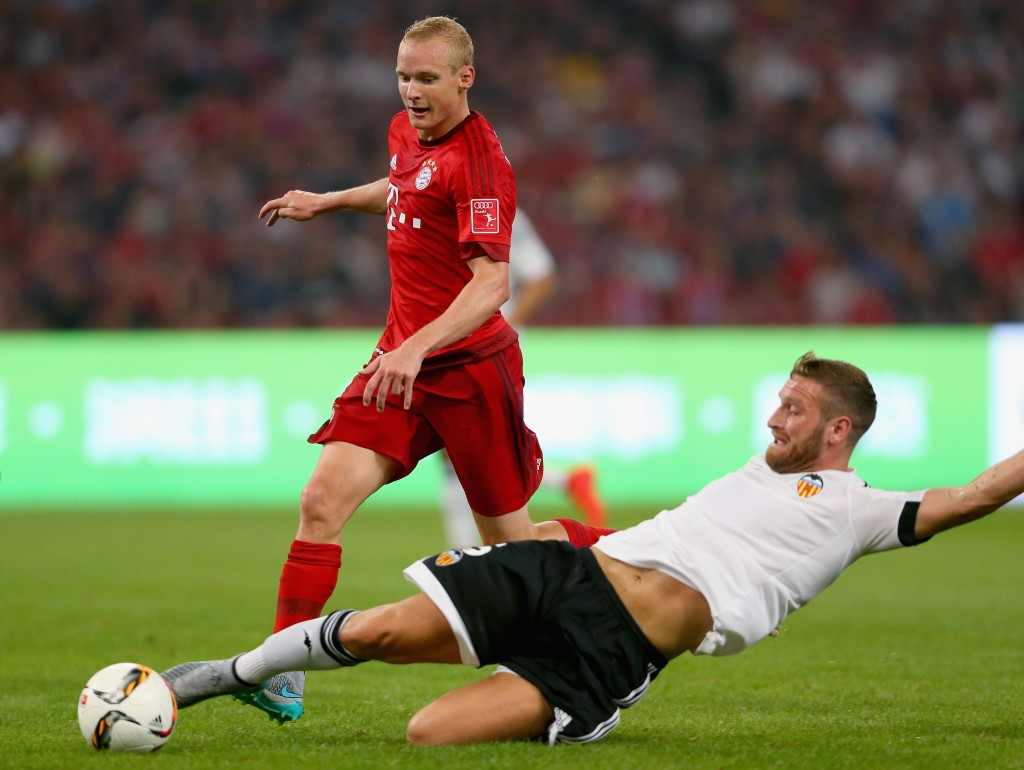 BEIJING, CHINA - JULY 18: Sebastian Rode (L) of Muenchen battles for the ball with Shkodran Mustafi of Valencia during the international friendly match between FC Bayern Muenchen and Valencia FC at the Audi Football Summit 2015 during at National Stadium on July 18, 2015 in Beijing, China. (Photo by Alexander Hassenstein/Bongarts/Getty Images)