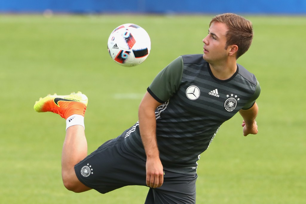 EVIAN-LES-BAINS, FRANCE - JULY 05: Mario Goetze of Germany plays with the ball during a Germany training session at Ermitage Evian on July 05, 2016 in Evian-les-Bains, France. (Photo by Alexander Hassenstein/Getty Images)