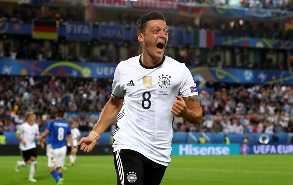 BORDEAUX, FRANCE - JULY 02: Mesut Oezil of Germany celebrates scoring the opening goal during the UEFA EURO 2016 quarter final match between Germany and Italy at Stade Matmut Atlantique on July 2, 2016 in Bordeaux, France. (Photo by Alexander Hassenstein/Getty Images)