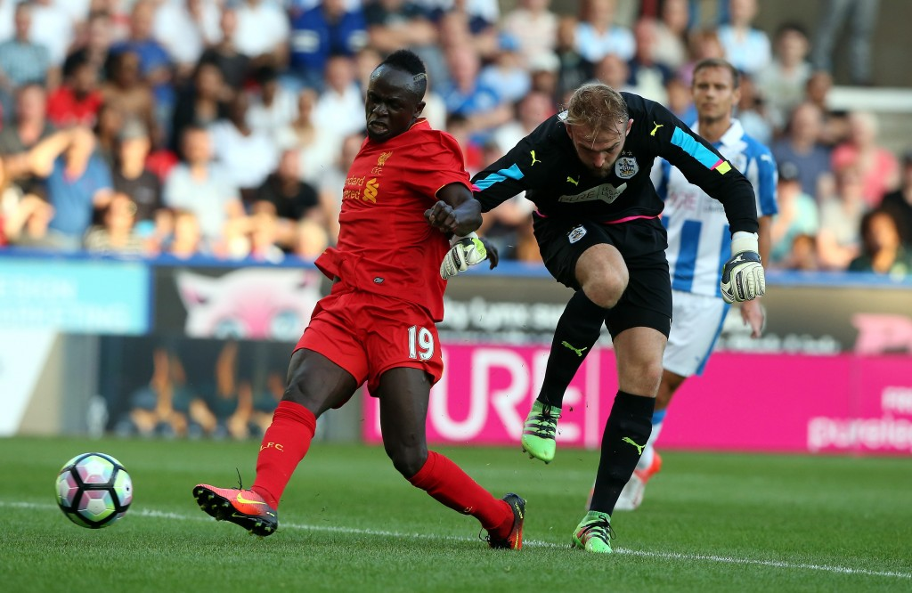 HUDDERSFIELD, ENGLAND - JULY 20: Joel Coleman(R) of Huddersfield Town challenged by Sadio Mane of Liverpool during the Pre-Season Friendly match between Huddersfield Town and Liverpool at the Galpharm Stadium on July 20, 2016 in Huddersfield, England. (Photo by Nigel Roddis/Getty Images)