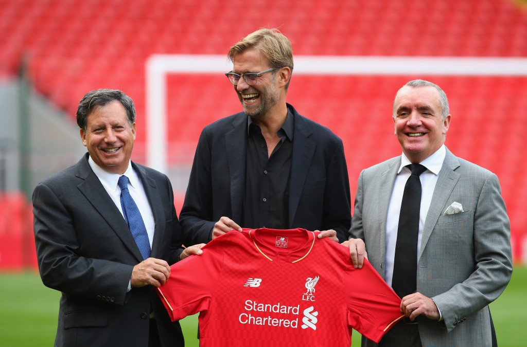 LIVERPOOL, ENGLAND - OCTOBER 09: Jurgen Klopp is unveiled as the new manager of Liverpool FC as he stands alongside Tom Werner (l) the chairman and Ian Ayre (r) the chief executive during a photocall at Anfield on October 9, 2015 in Liverpool, England. (Photo by Alex Livesey/Getty Images)