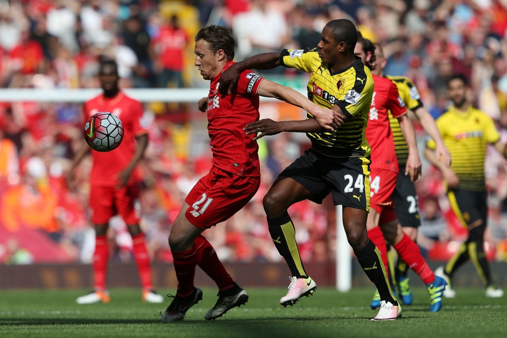 LIVERPOOL, ENGLAND - MAY 08: Lucas Leiva of Liverpool holds off Odion Ighalo of Watford during the Barclays Premier League match between Liverpool and Watford at Anfield on May 8, 2016 in Liverpool, England. (Photo by Jan Kruger/Getty Images)