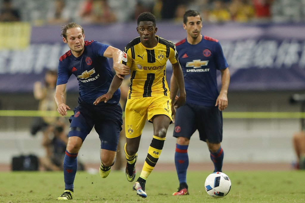 SHANGHAI, CHINA - JULY 22: Daley Blind of Manchester United competes for the ball with Ousmane Dembele of Borussia Dortmund during the International Champions Cup match between Manchester United and Borussia Dortmund at Shanghai Stadium on July 22, 2016 in Shanghai, China. (Photo by Lintao Zhang/Getty Images)
