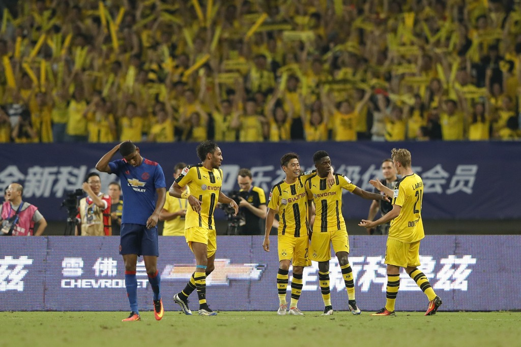 SHANGHAI, CHINA - JULY 22: Ousmane Dembele celebrates with teammates after scoring their second goal during the International Champions Cup match between Manchester United and Borussia Dortmund at Shanghai Stadium on July 22, 2016 in Shanghai, China. (Photo by Lintao Zhang/Getty Images)