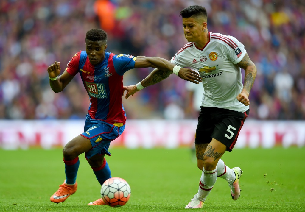 LONDON, ENGLAND - MAY 21: Wilfried Zaha of Crystal Palace battles with Marcos Rojo of Manchester United during The Emirates FA Cup Final match between Manchester United and Crystal Palace at Wembley Stadium on May 21, 2016 in London, England. (Photo by Shaun Botterill/Getty Images)
